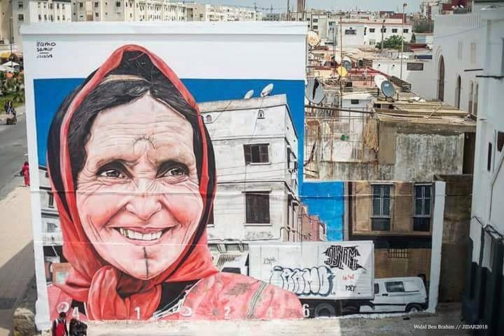 Murale di Iramo Samir realizzato partendo da una foto di Marghadi Said, per il festival di street art Jidar (Rabat), 2018